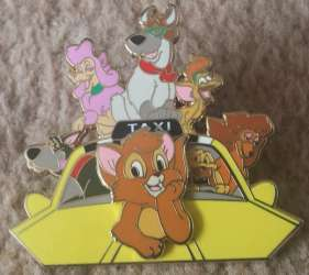 Oliver and Company on a yellow cab